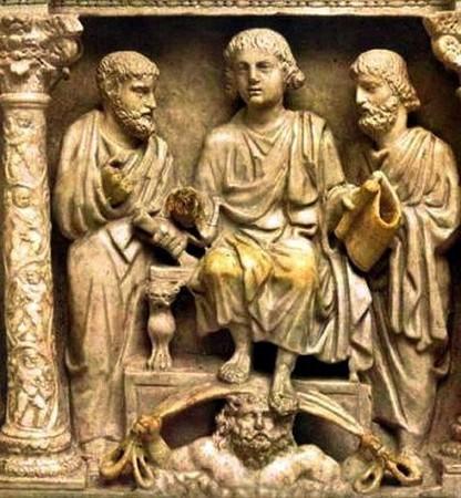 Le Christ, très juvénile, en position dominante, entouré de saint Paul et de saint Pierre. Sarcophage de Julius Bassus. Fin du IV° siècle.