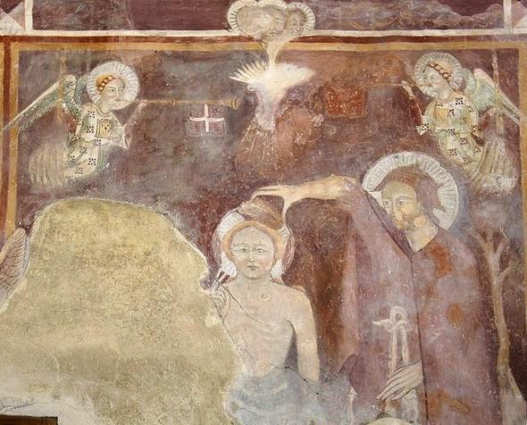 Dans le Jourdain, le baptême du Christ par Jean Baptiste.