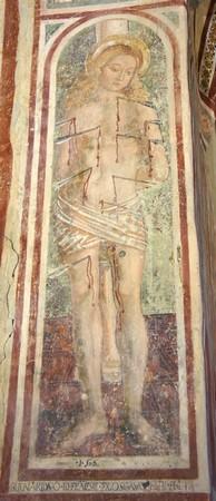 h -  Saint Sébastien criblé de flèches.Il fait face à la nef.1506
