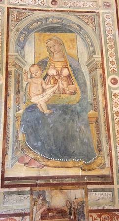 La Madone à l'Enfant.A ses pieds, une scènette décrivant une intervention miraculeuse.1506