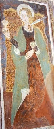 Sainte Lucie.Modeste artiste de la fin du XV° siècle.En main, le calice contenant ses deux yeux.Un poignard planté dans sa gorge.